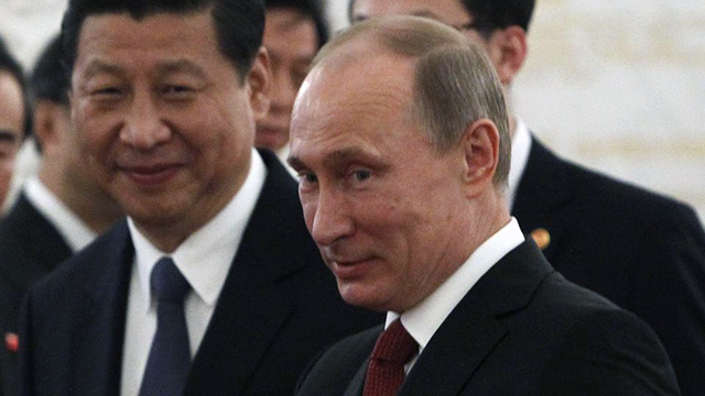 "Vladimir Putin Pays Tribute to China's ""First MILF"""